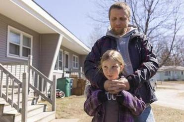 """We hope to move out of here,"" said Jamie Tucker, pictured with his daughter Samara, ""but we have no place to go yet. The rent here is pretty cheap."""